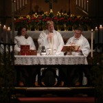 Fr. Charlie celebrates the Eucharist at the 8:30 service on Easter Day.